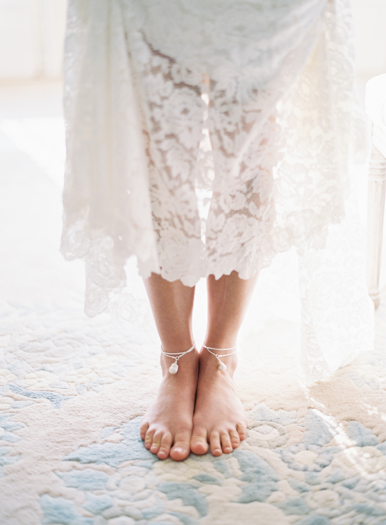 Bride wearing dress with anklets
