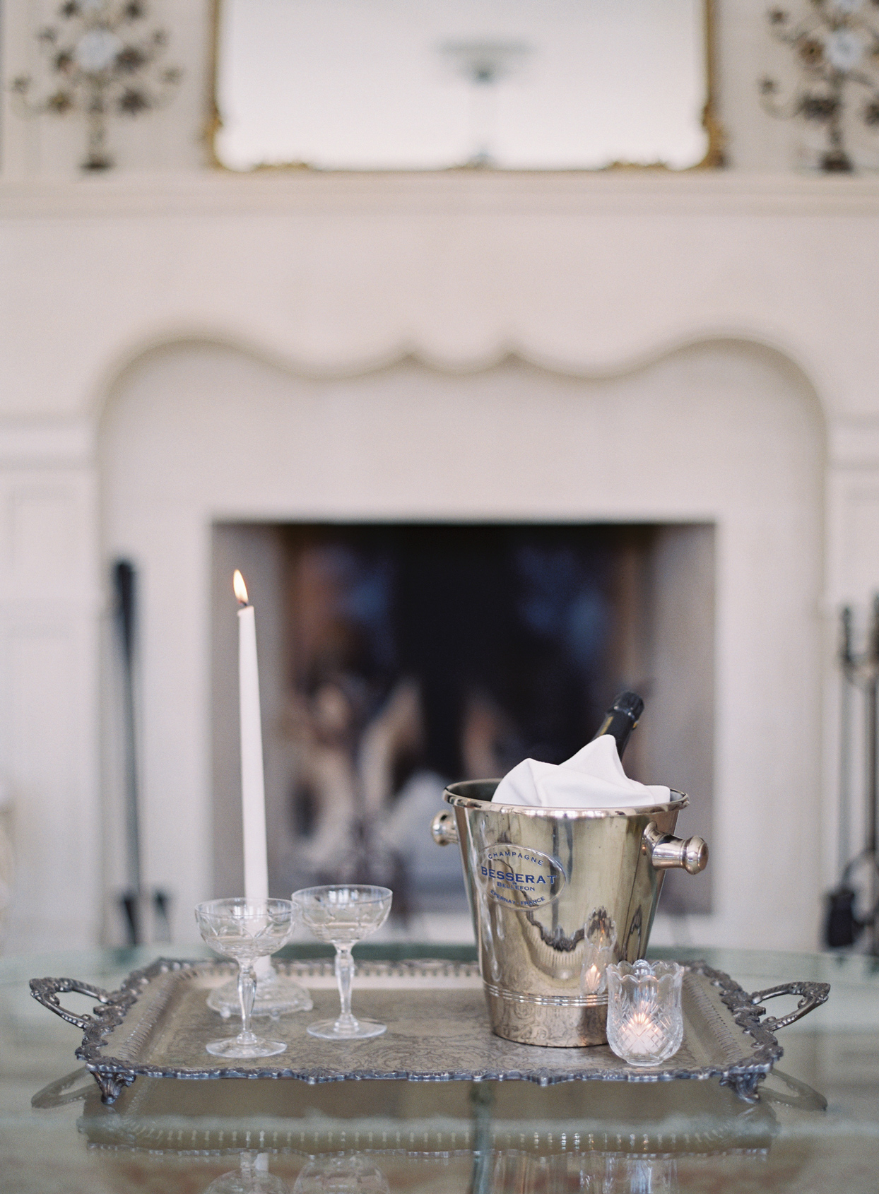 Champagne bucket on tray with glassware