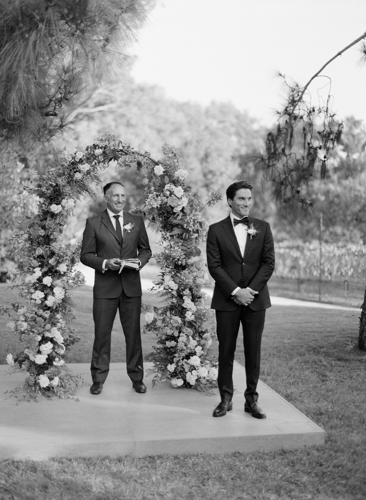 Groom and officiant waiting at the altar
