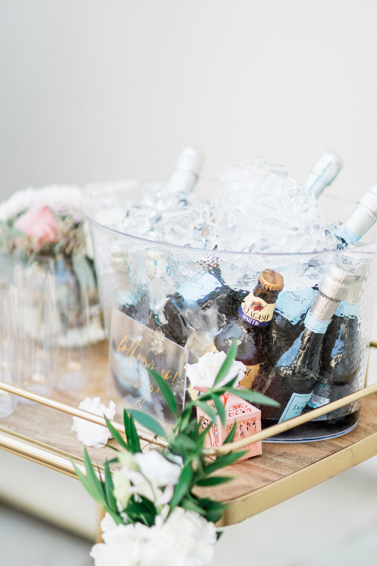 Bucket of ice with champagne bottles
