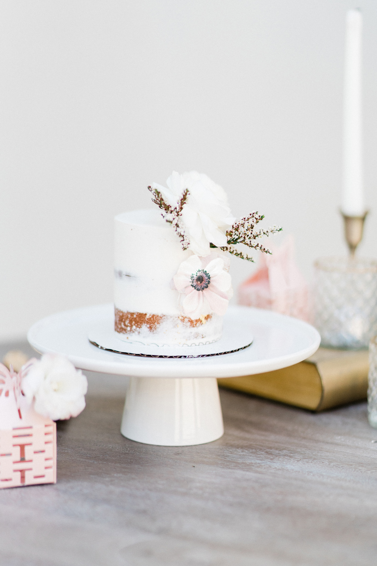 Two-tier white frosted cake
