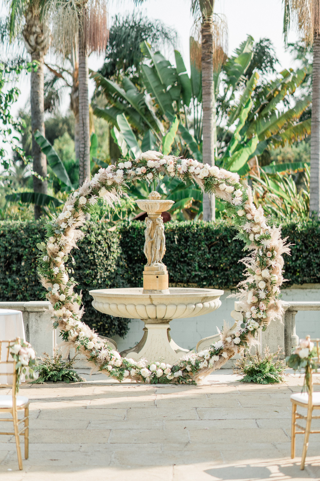 Archway with flowers and fountain