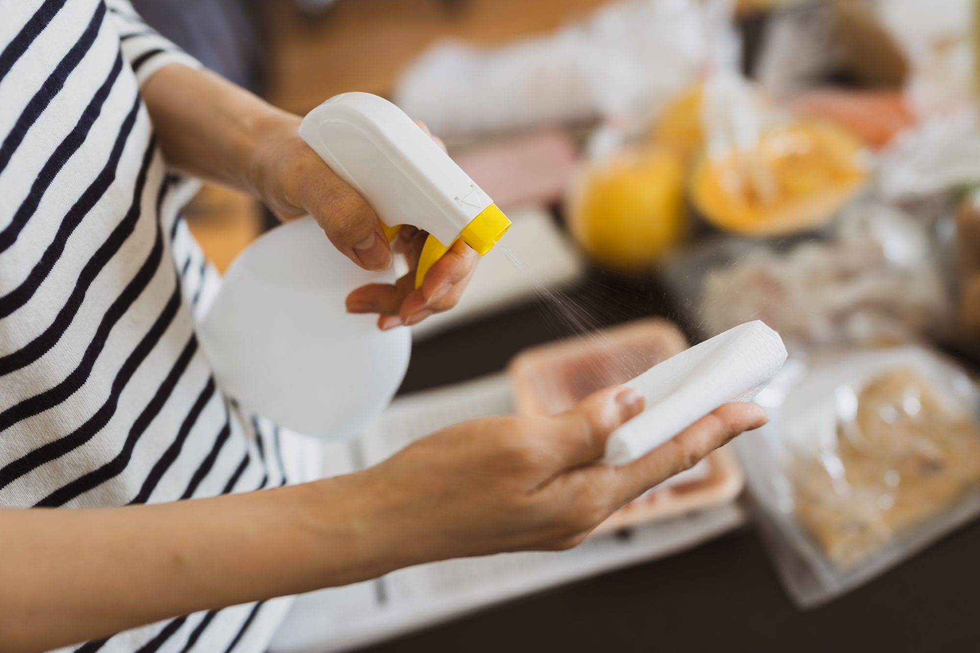 woman disinfecting groceries
