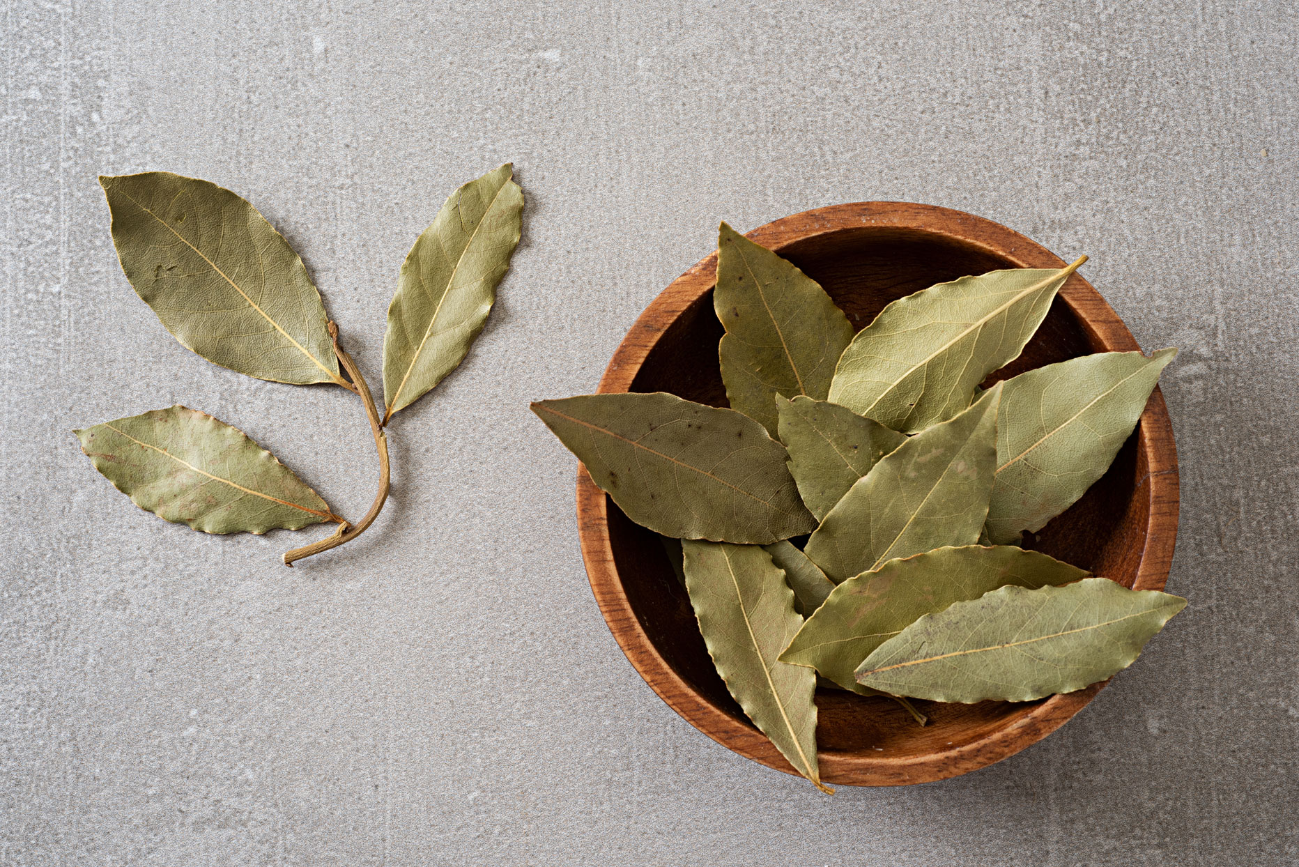 Bay leaves in a wooden bowl