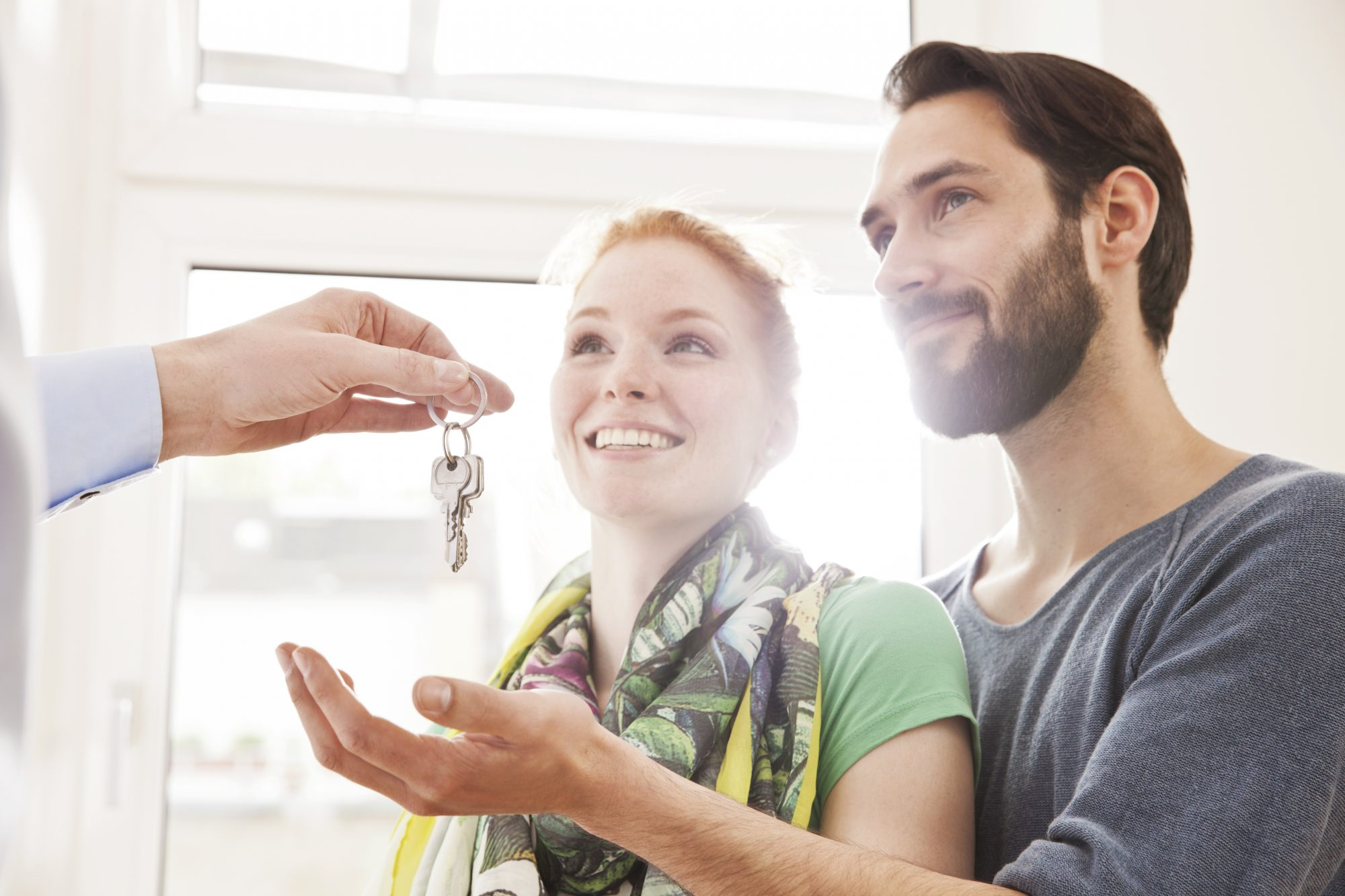 couple receiving a house key