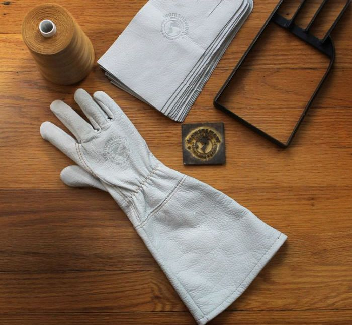 soft blue leather gloves atop wood table