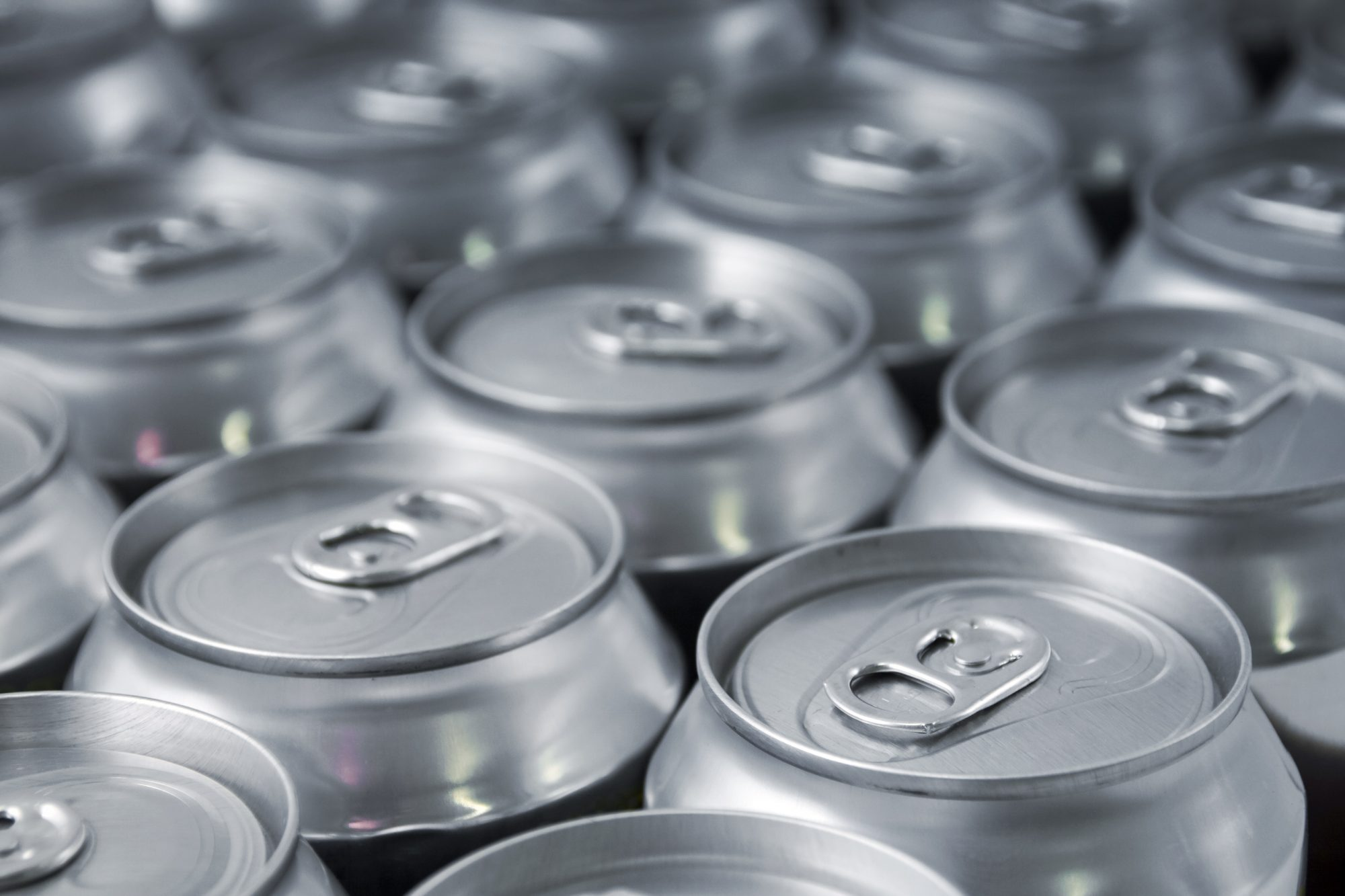 beer or soda cans in rows
