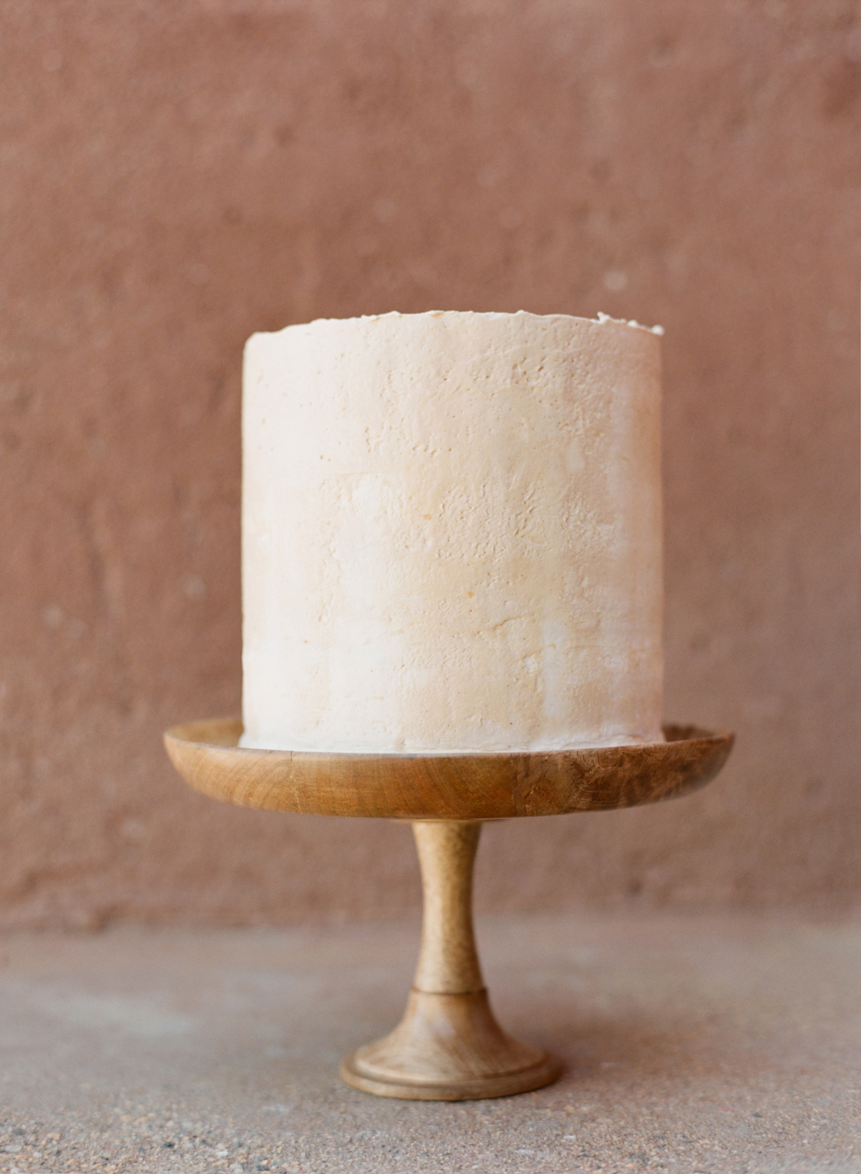 Small two-tiered simple frosted wedding cake