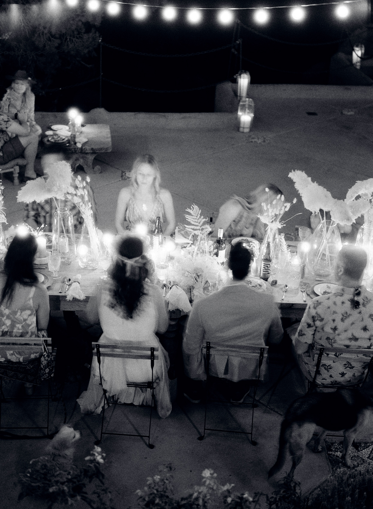 Black and white photo of bride and groom at dinner table