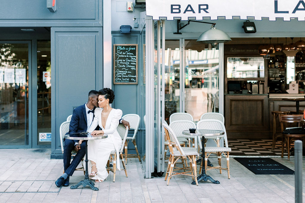 couple portrait outside french cafe