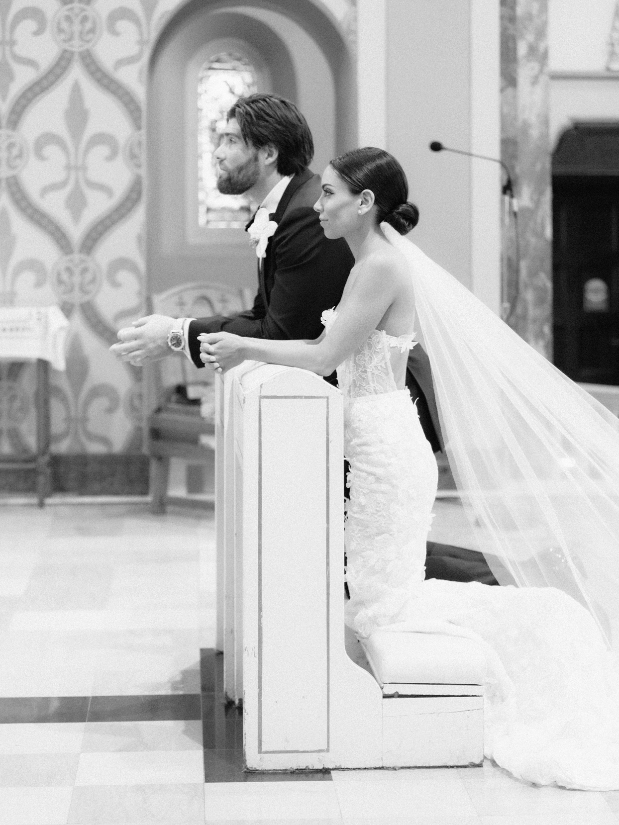couple kneeling at altar for wedding ceremony