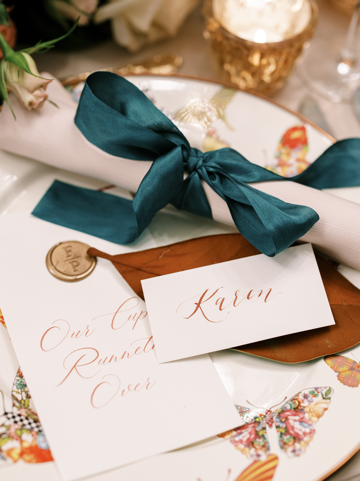 elegant wedding reception place settings and butterfly decor