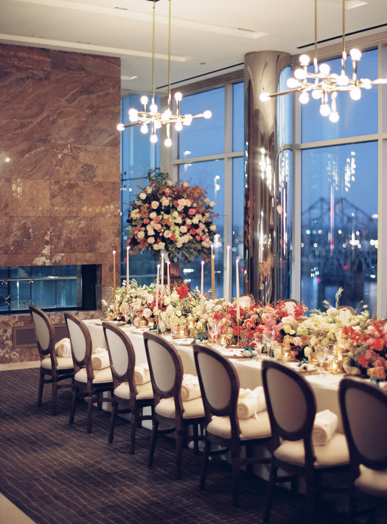 reception long table with rose garland