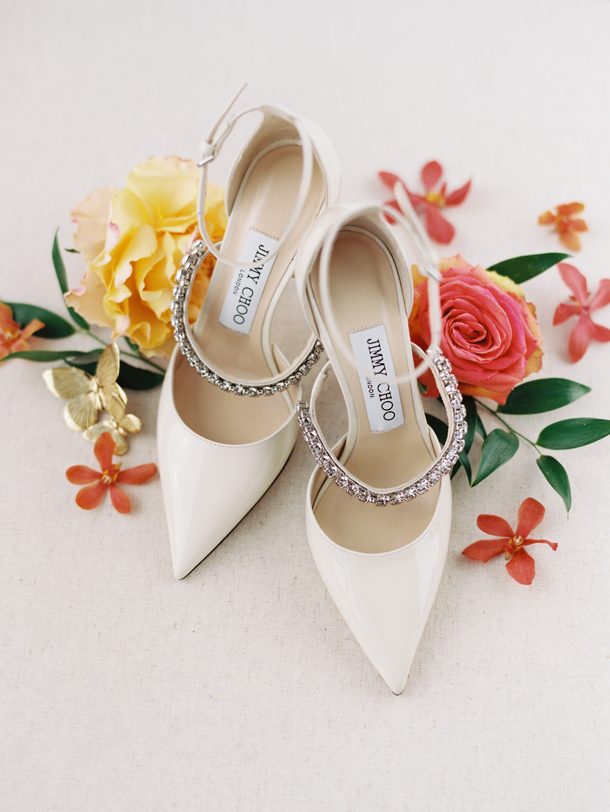 elegant white wedding shoes with diamonds and flowers