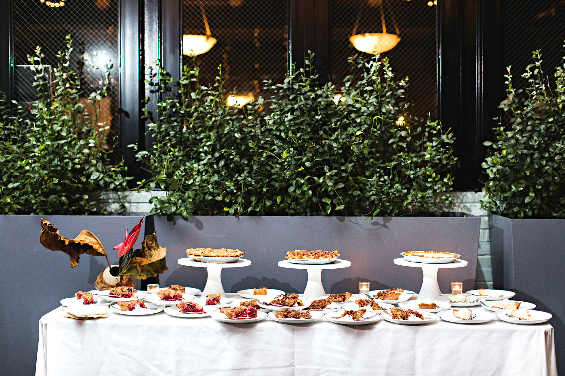 dessert table with variety of pies