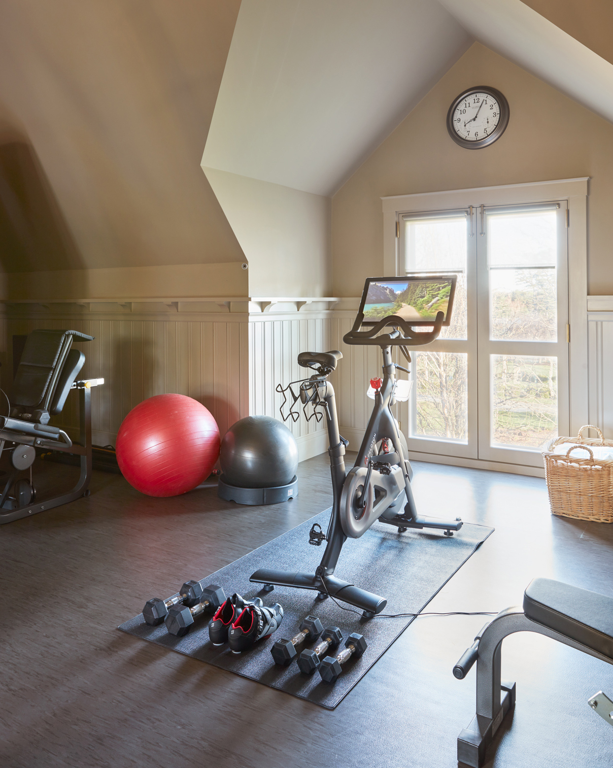 Martha's exercise room with Peloton bike and weights
