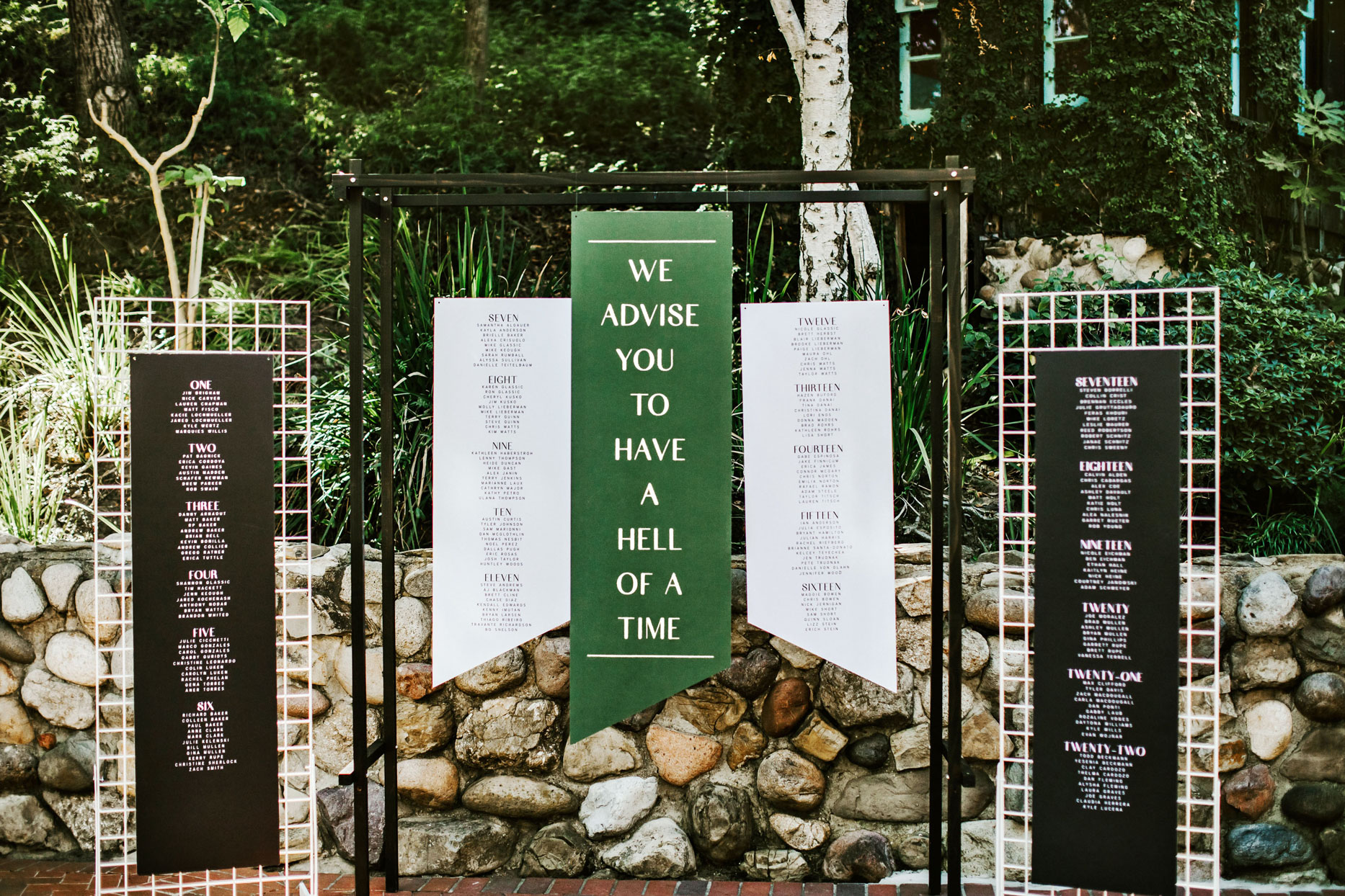 wedding banner seating charts with greenery background