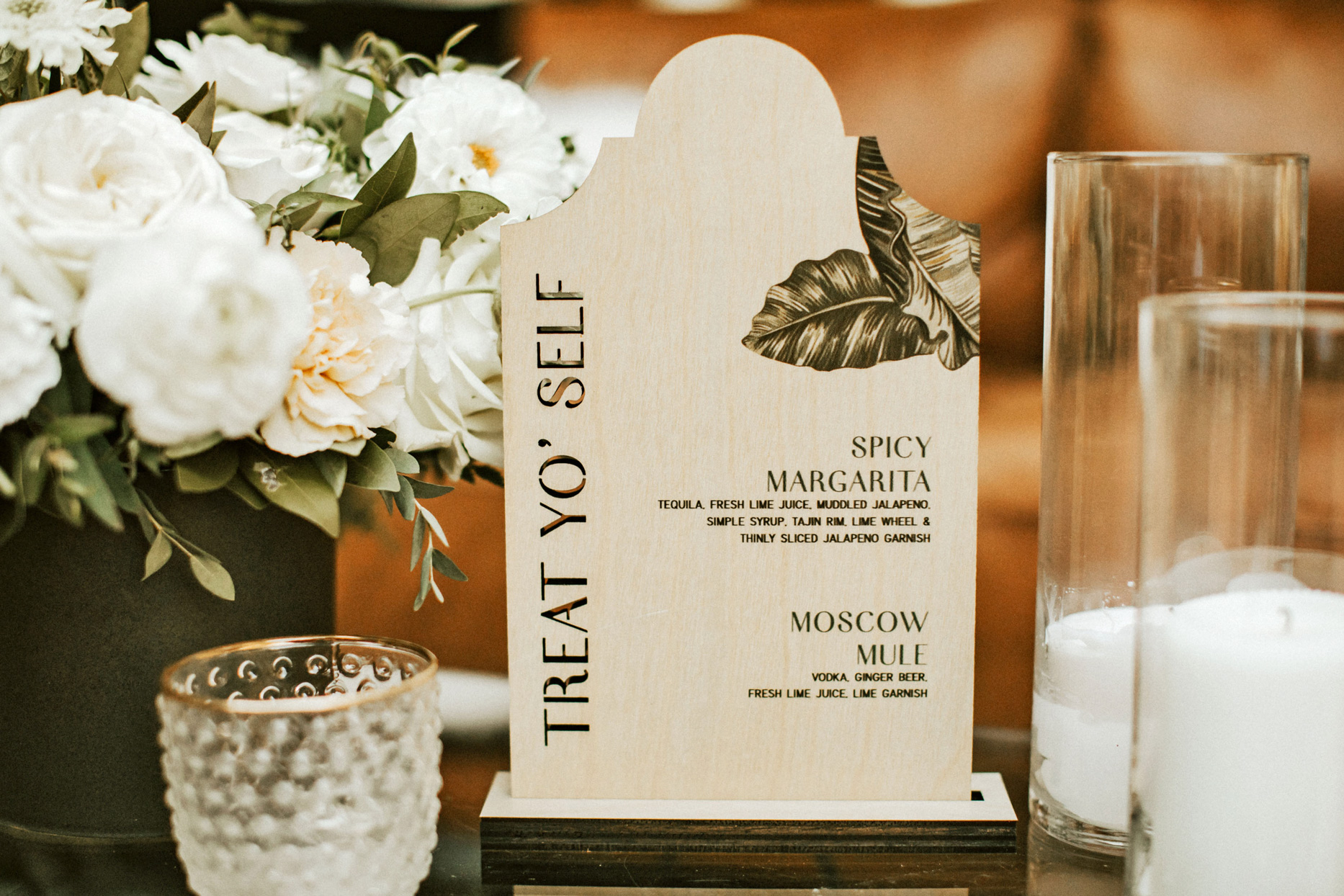 wooden wedding cocktail sign with flowers and candles
