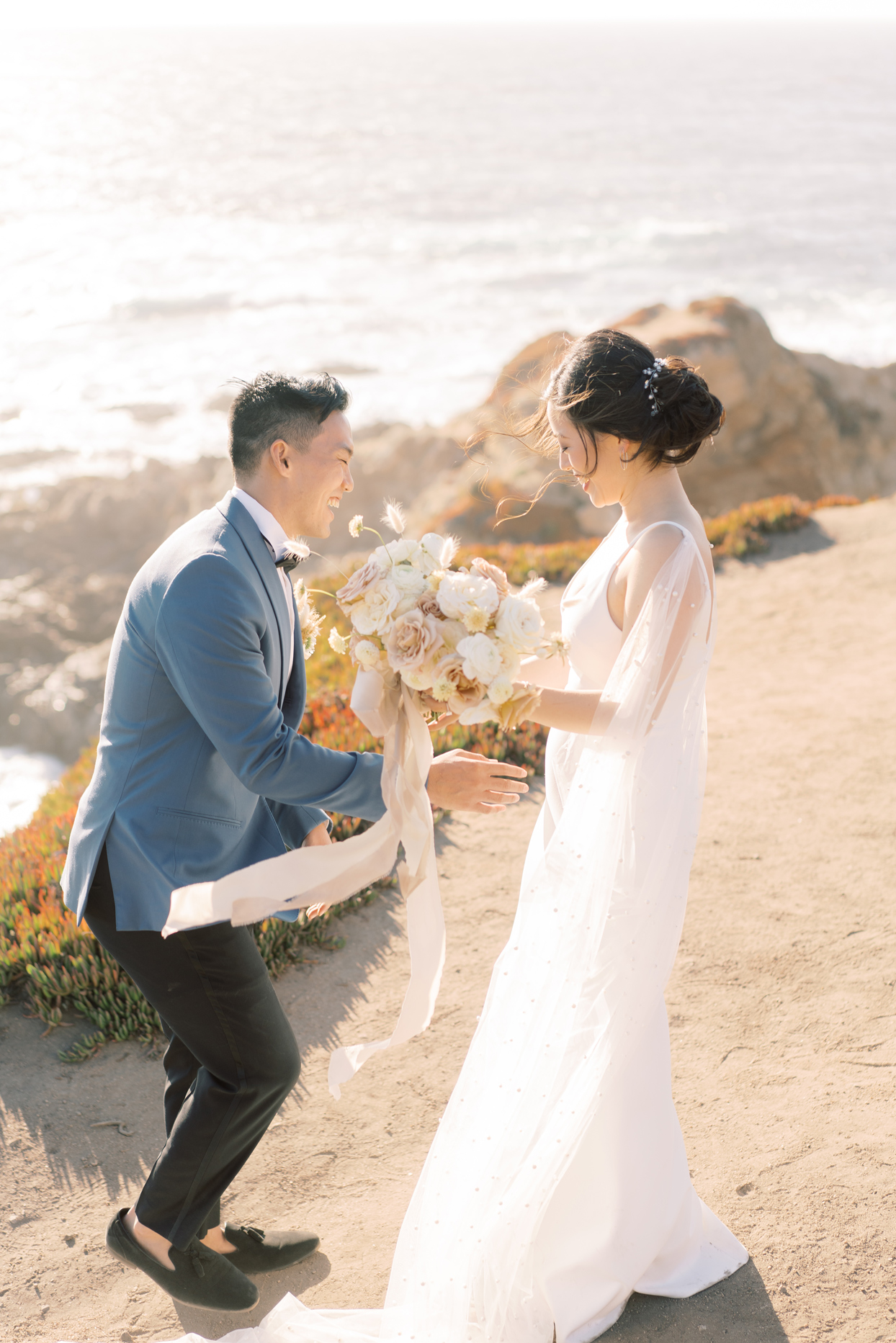 Groom and bride smiling with flower bouquet