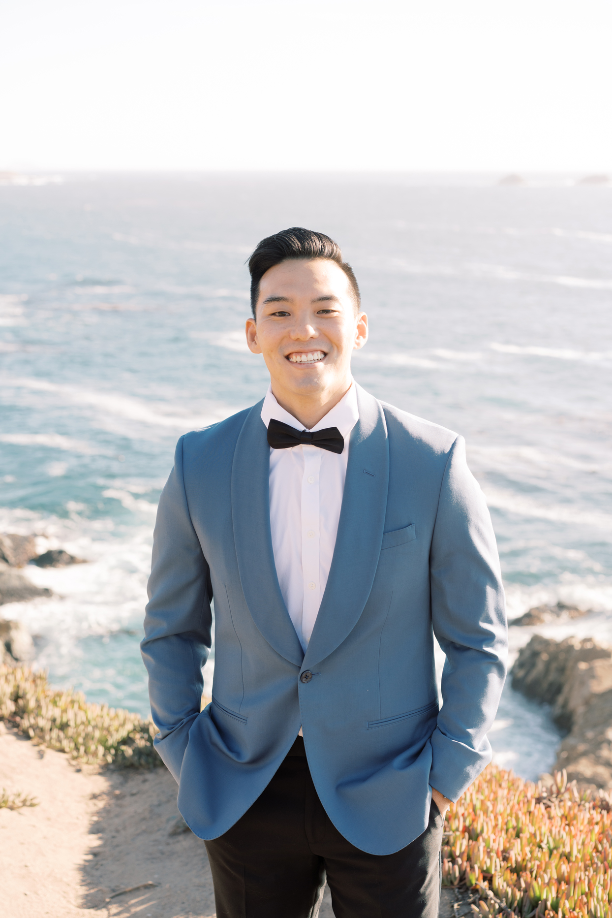 Groom in blue suit jacket and bowtie