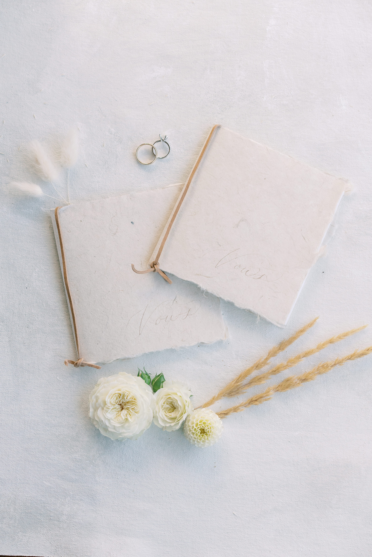 wedding rings and vow book