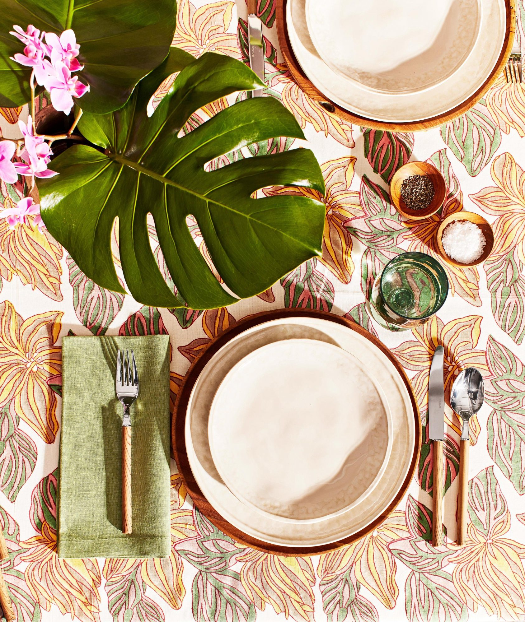 table cloth with palm tree design and tan table setting