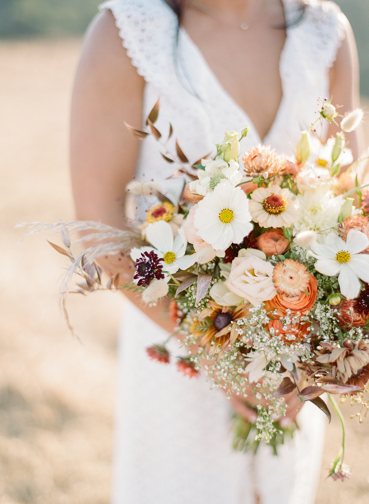bride's bouquet with white, yellow, and pink flowers