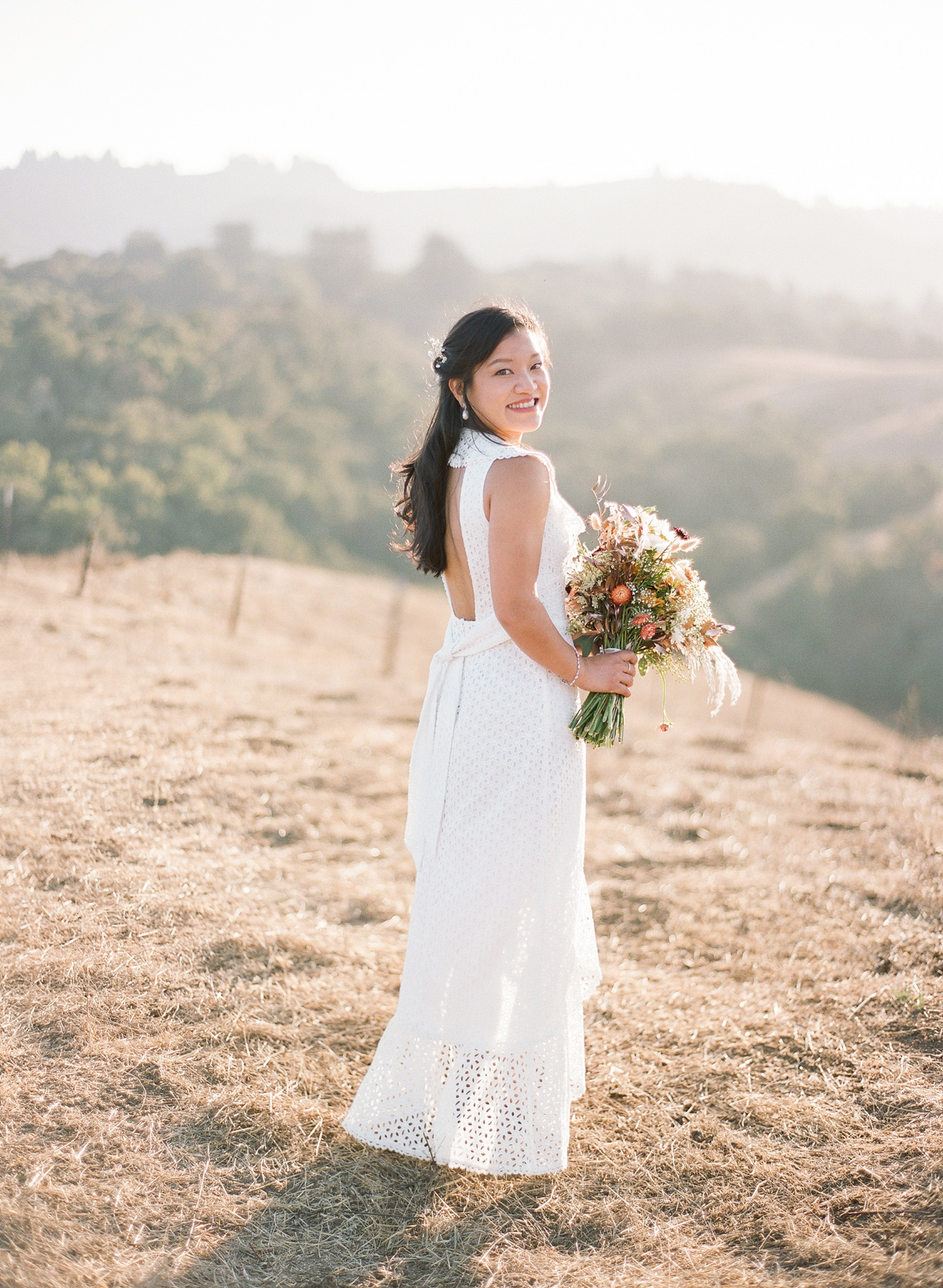 bride in wedding dress with floral bouquet