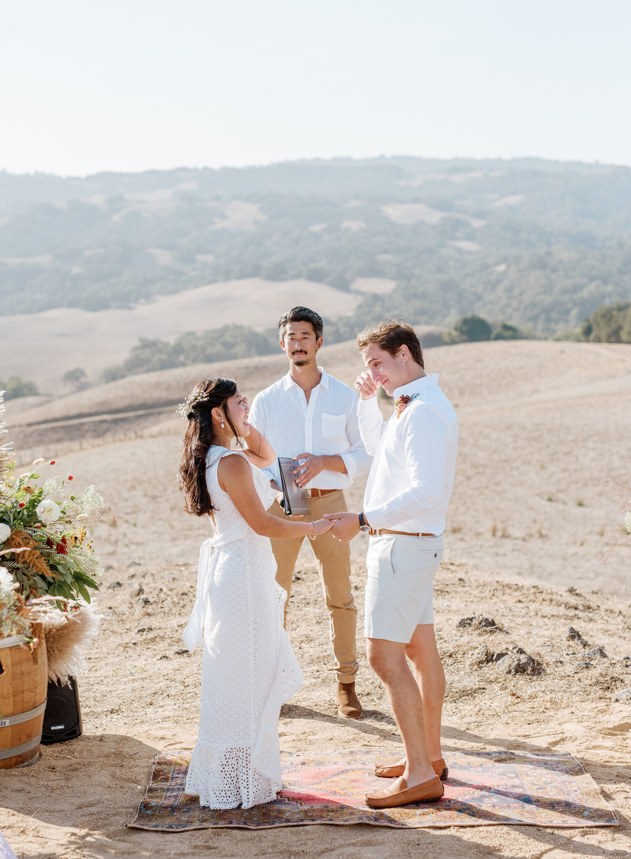 bride and groom share in emotional vows