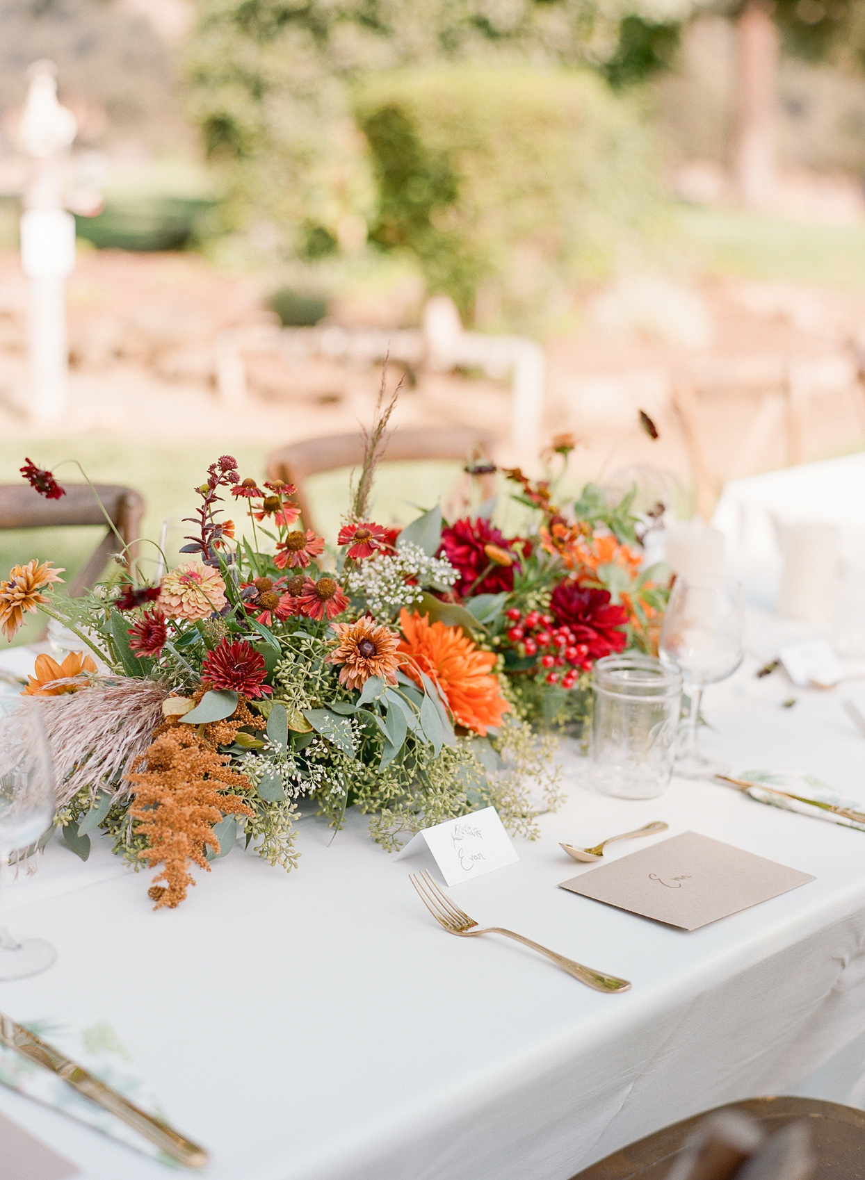table centerpieces with orange and red flowers