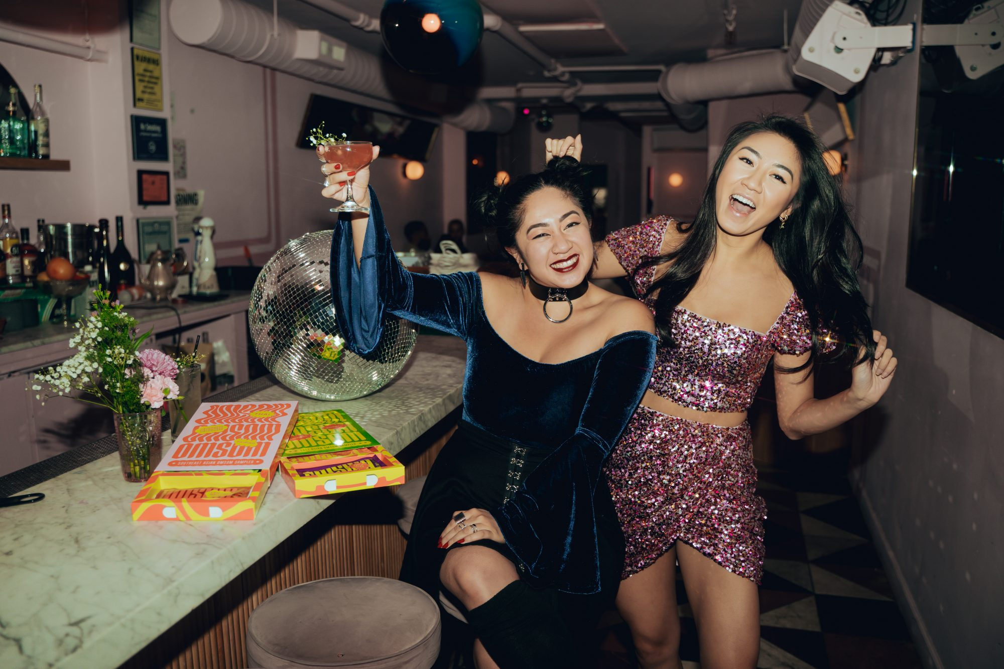 Vanessa and Kim Pham of Omsom at a bar
