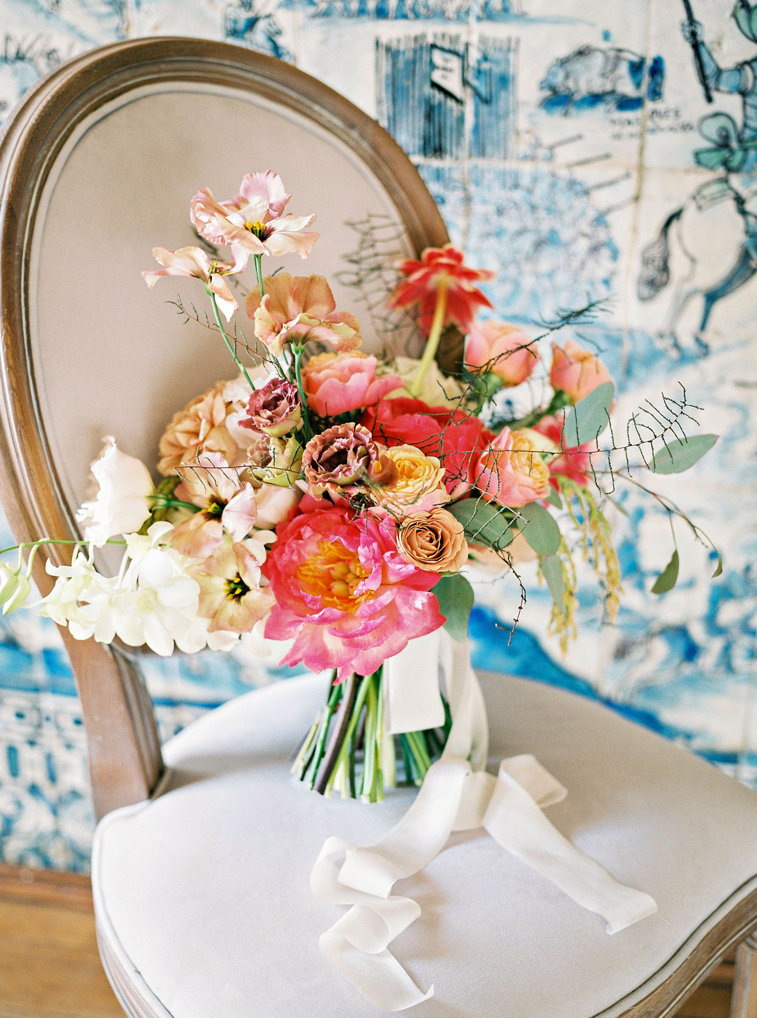 colorful wedding bouquet on chair