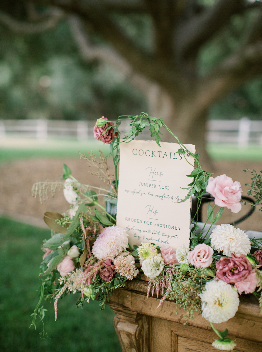 rustic wedding bar with mauve and cream flowers