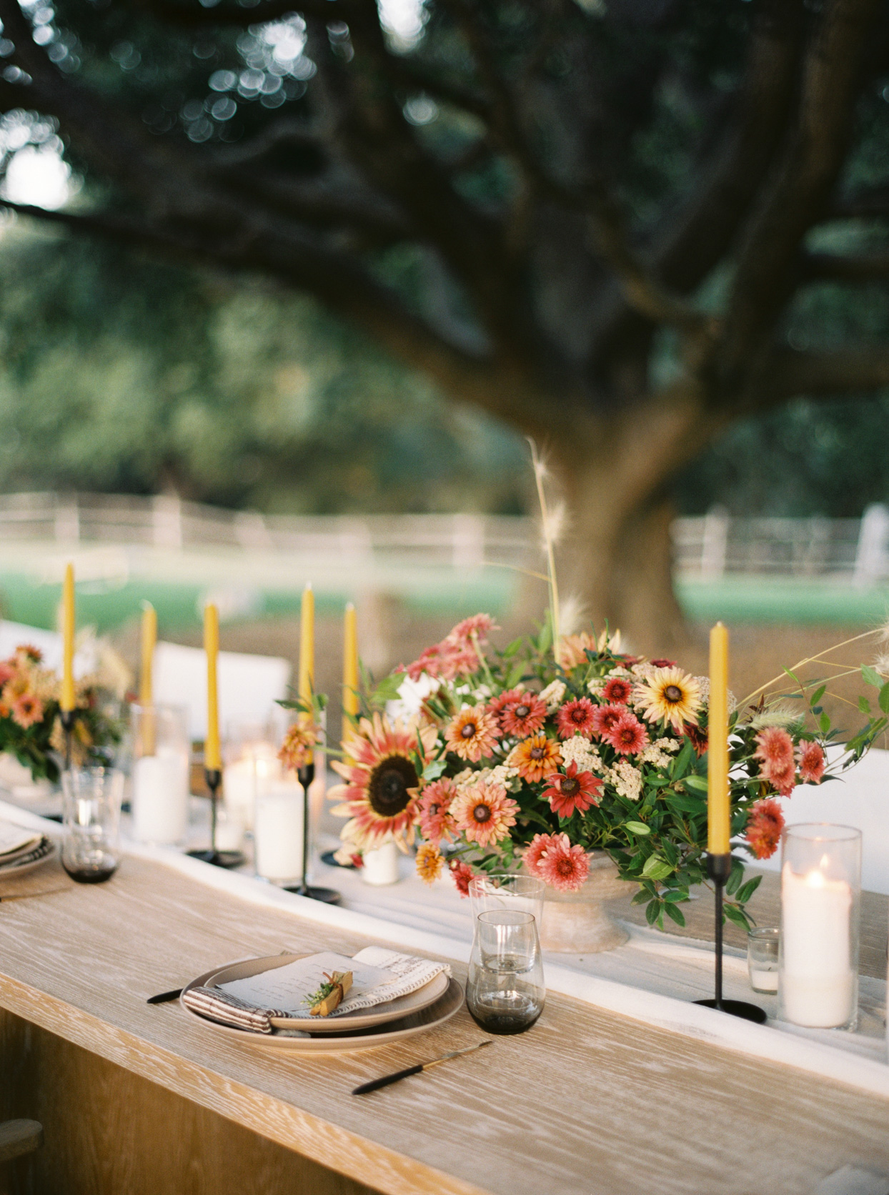 country style floral bouquet on rustic long wooden table