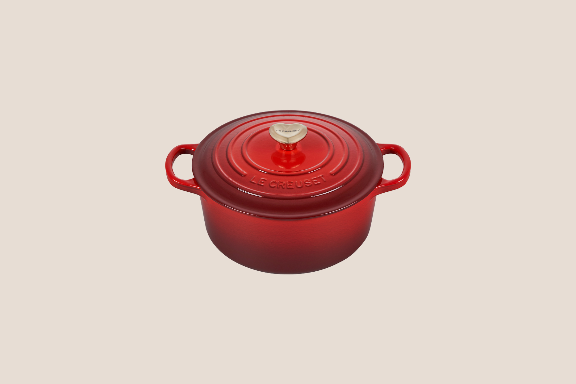 Le Creuset red pot with heart knob
