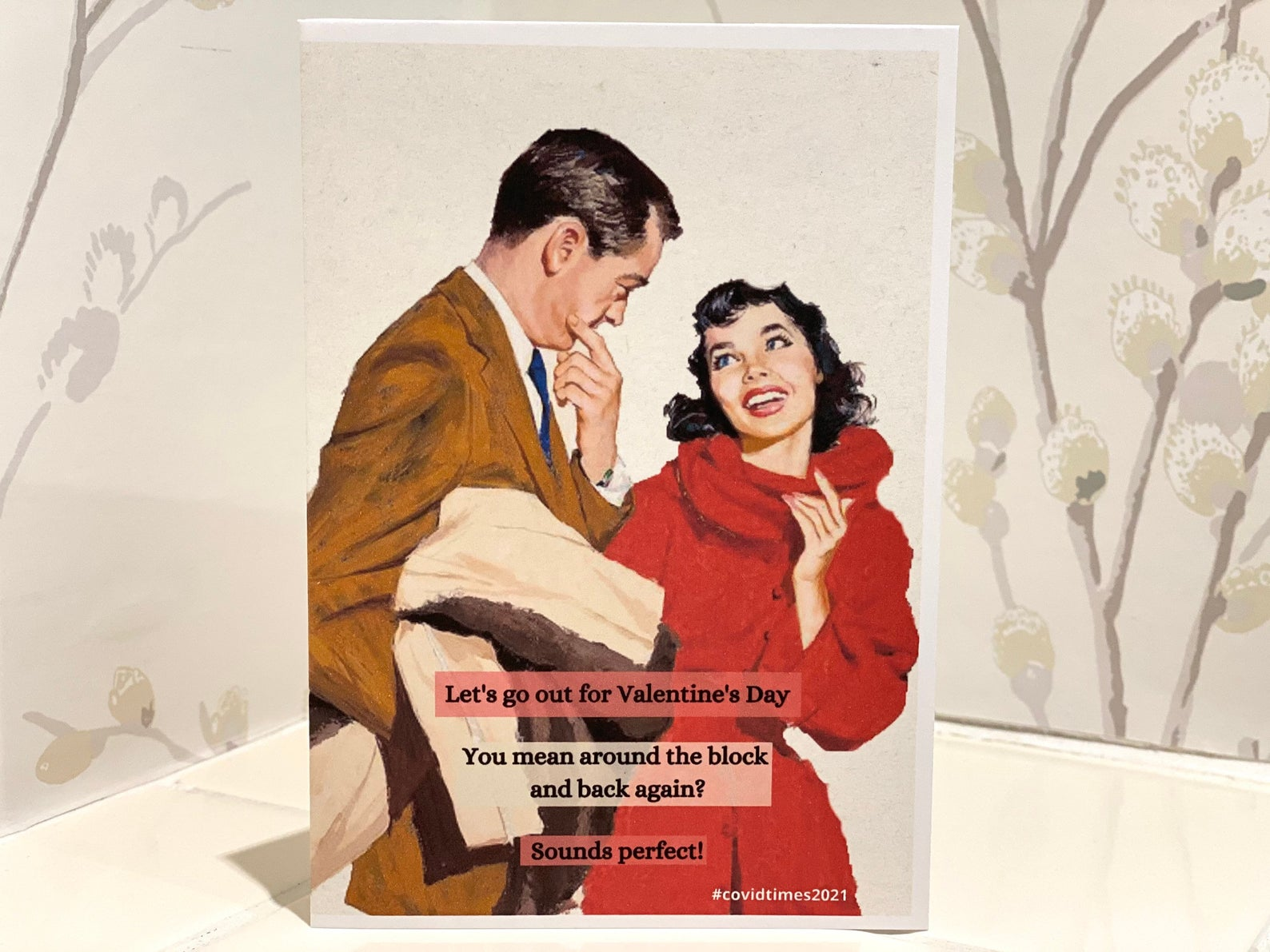 couple pictured on a vintage-style Valentine's Day card