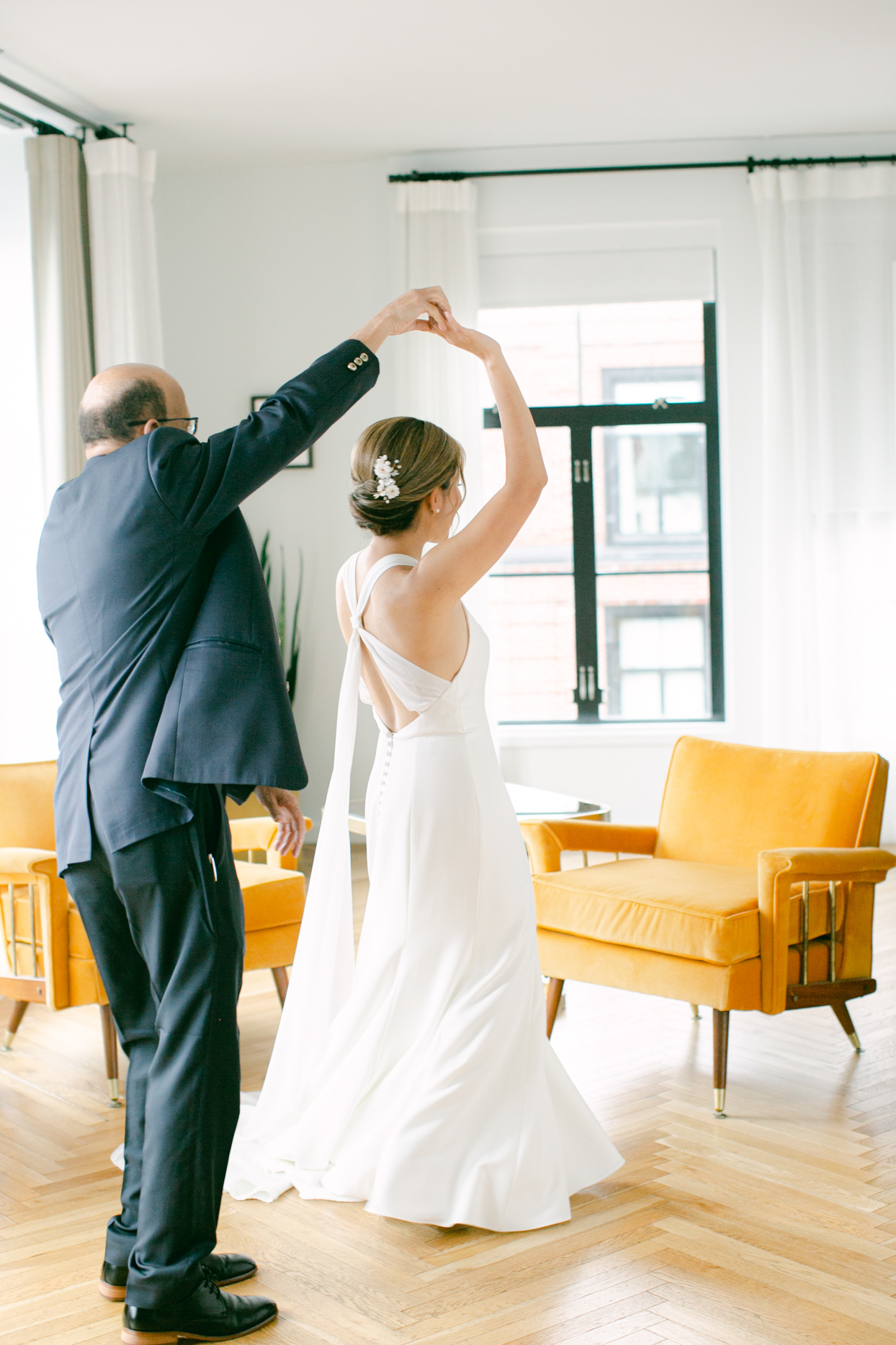 bride and father dancing before wedding