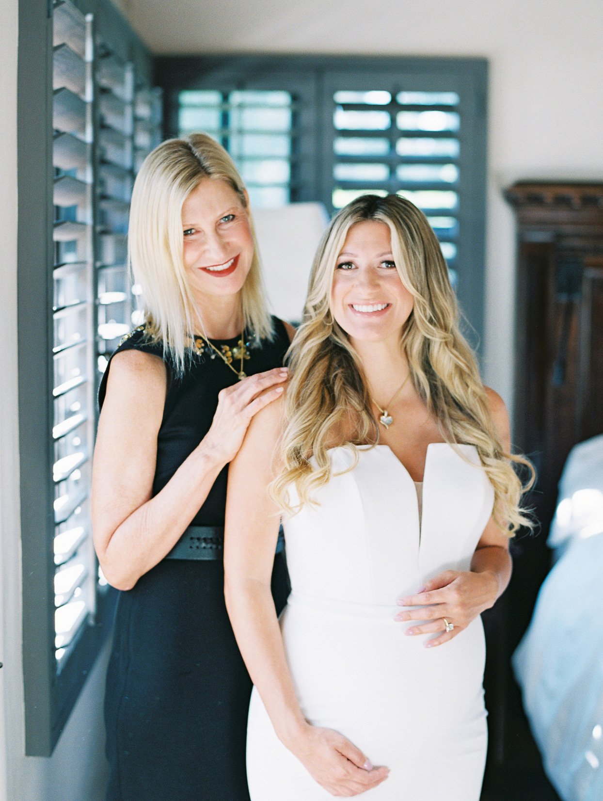 bride in white dress with mother before ceremony