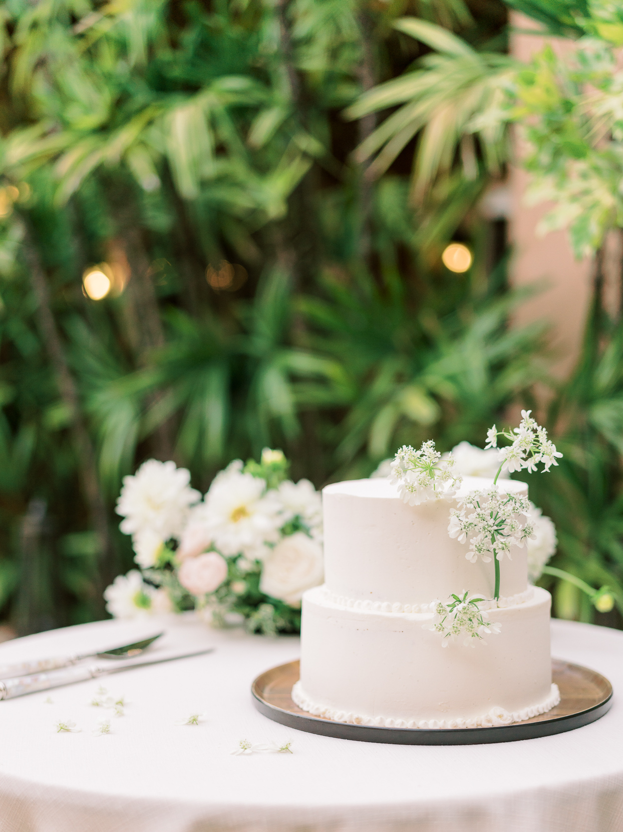 small white wedding cake with little flowers
