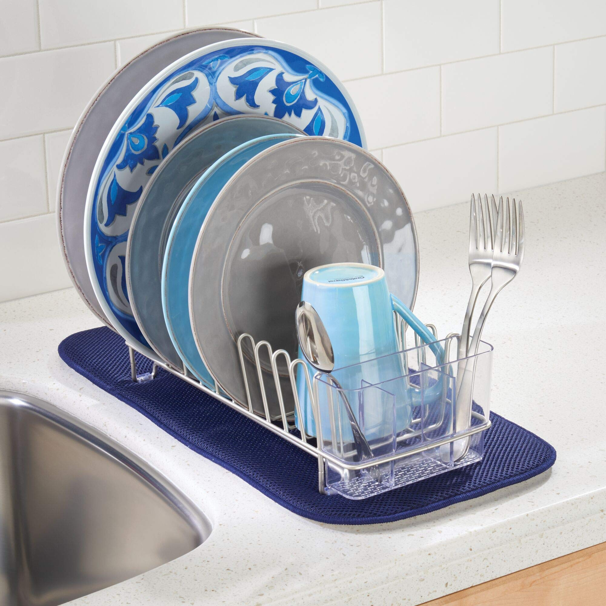 compact metal dish drainer full of dishes