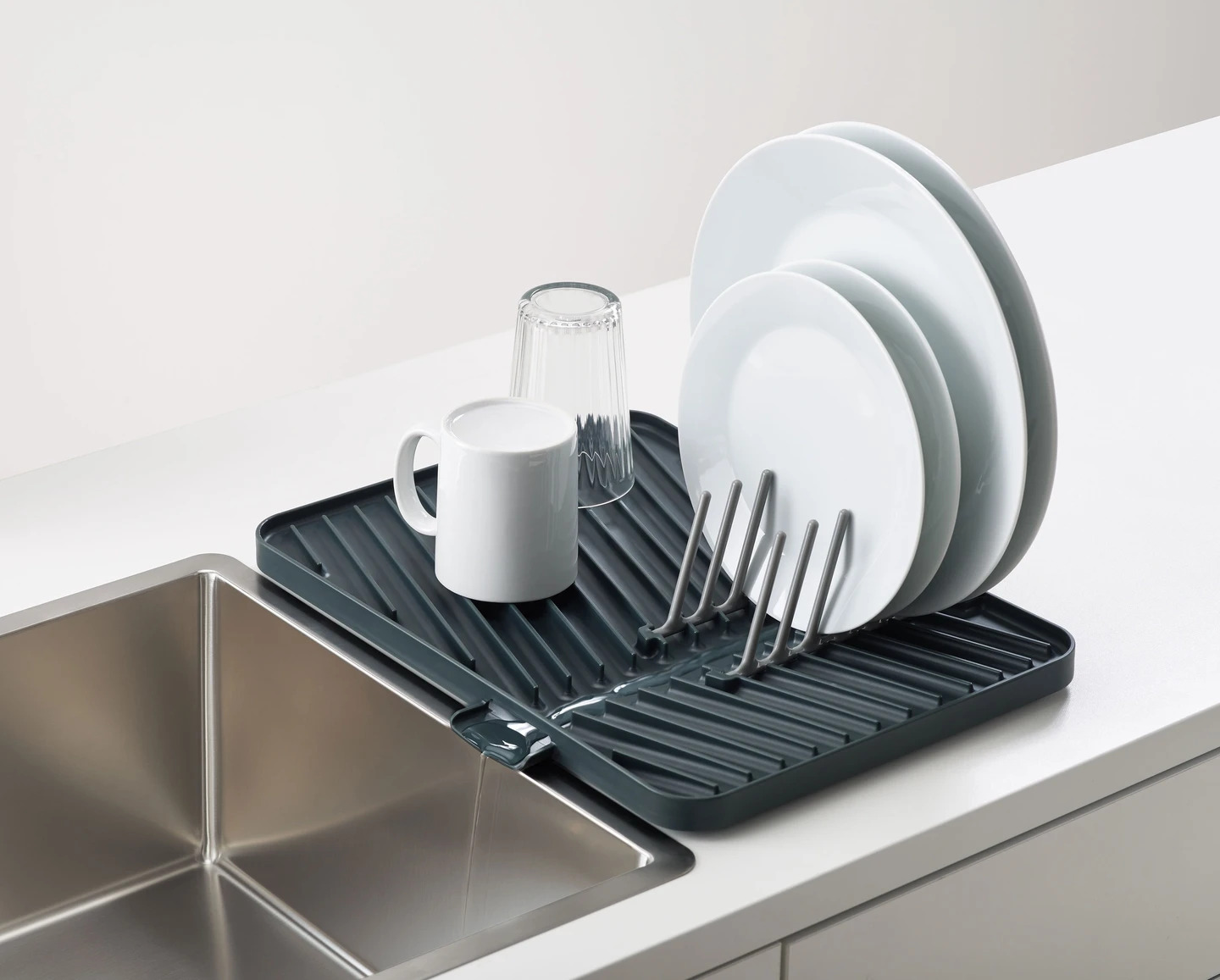folding dish rack with dishes drying
