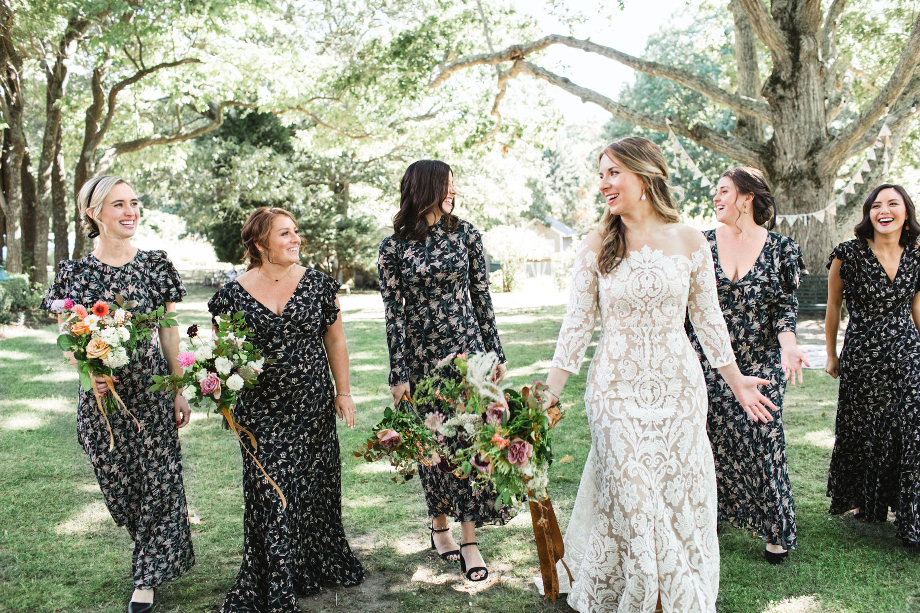 bride and bridesmaids walking in floral dresses