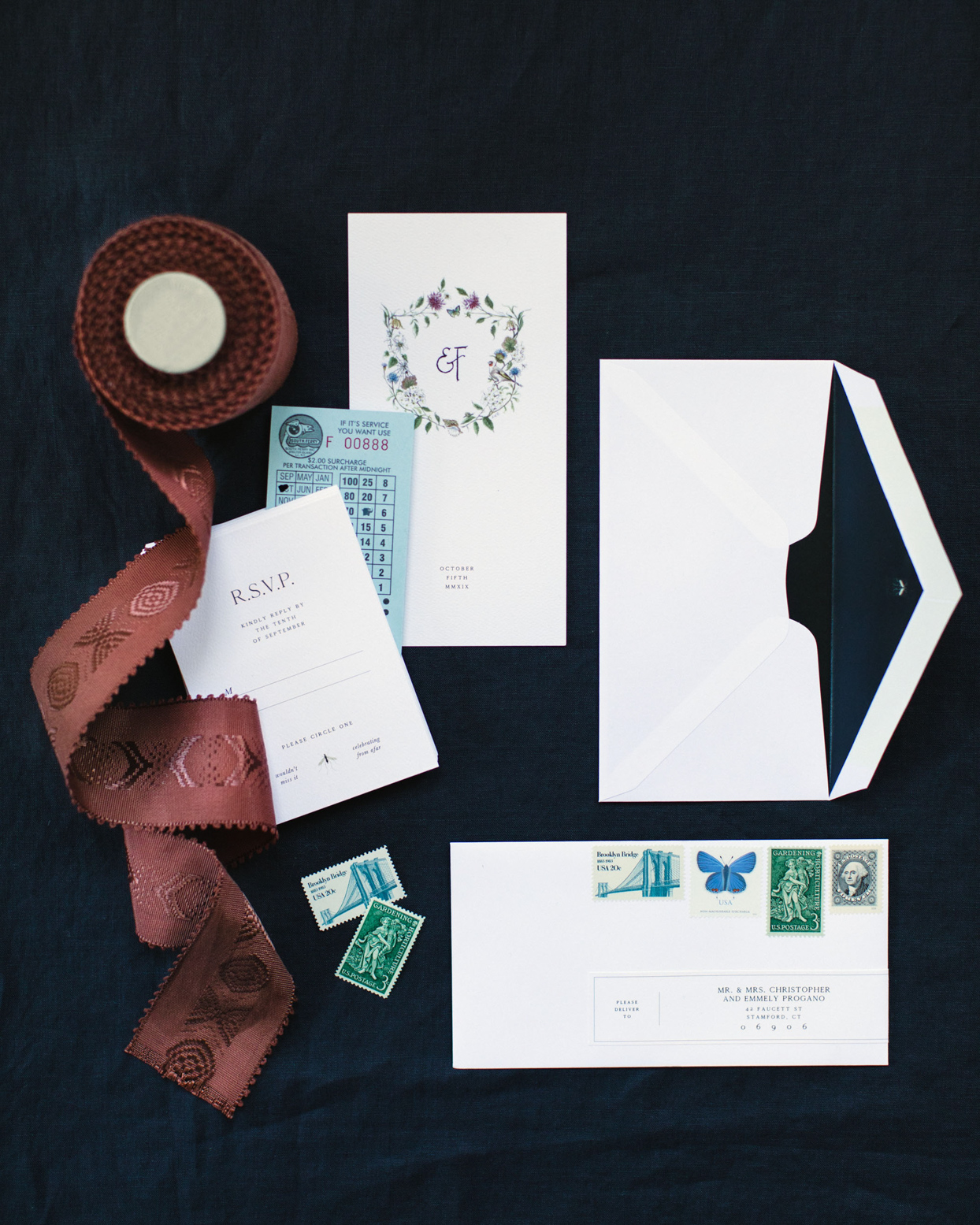 simple invitation suite with vintage stamps and ribbon accent