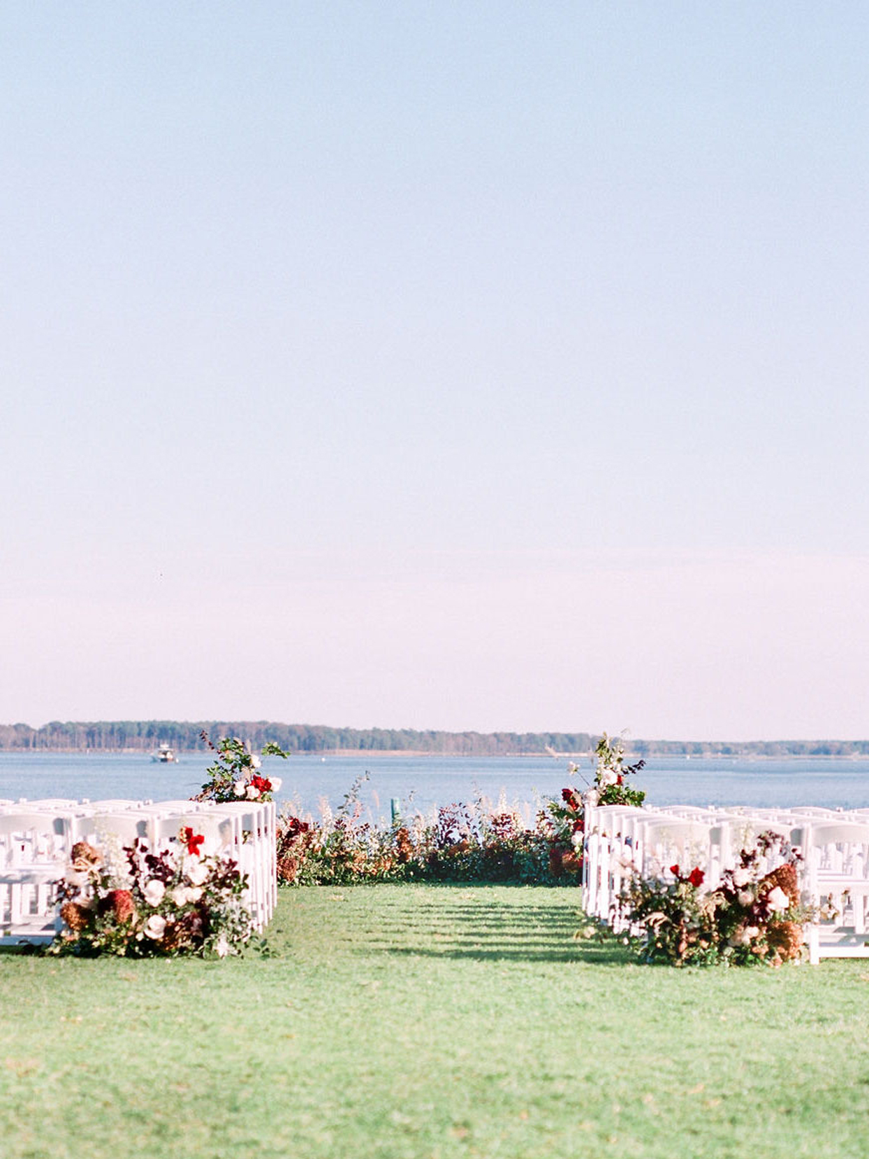 ceremony setup with with chairs and fall florals