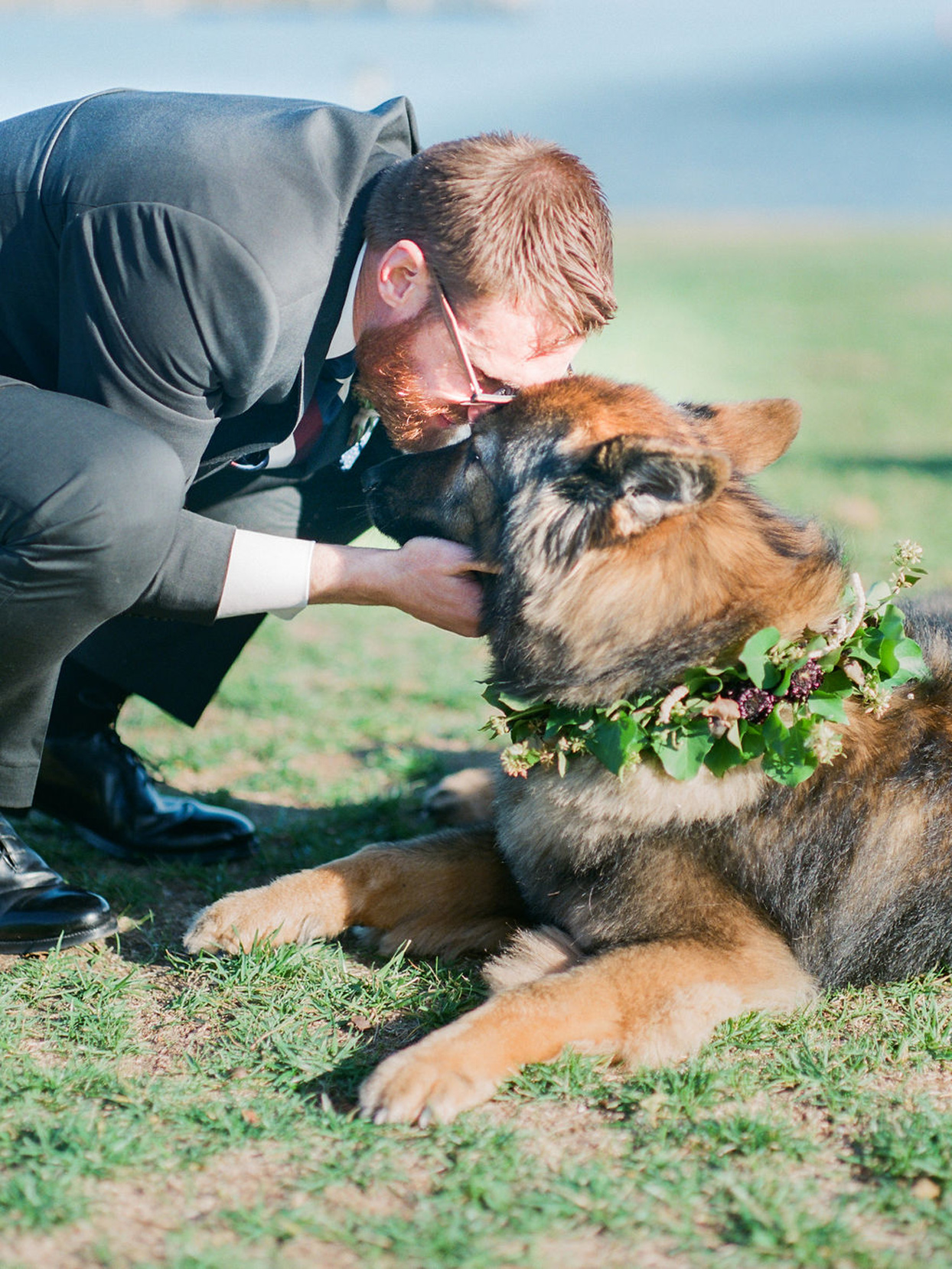 groom with dog wearing a floral wreath