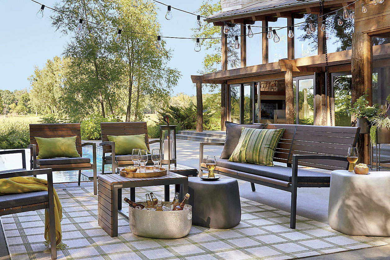 outdoor patio furniture with glass string lights hanging