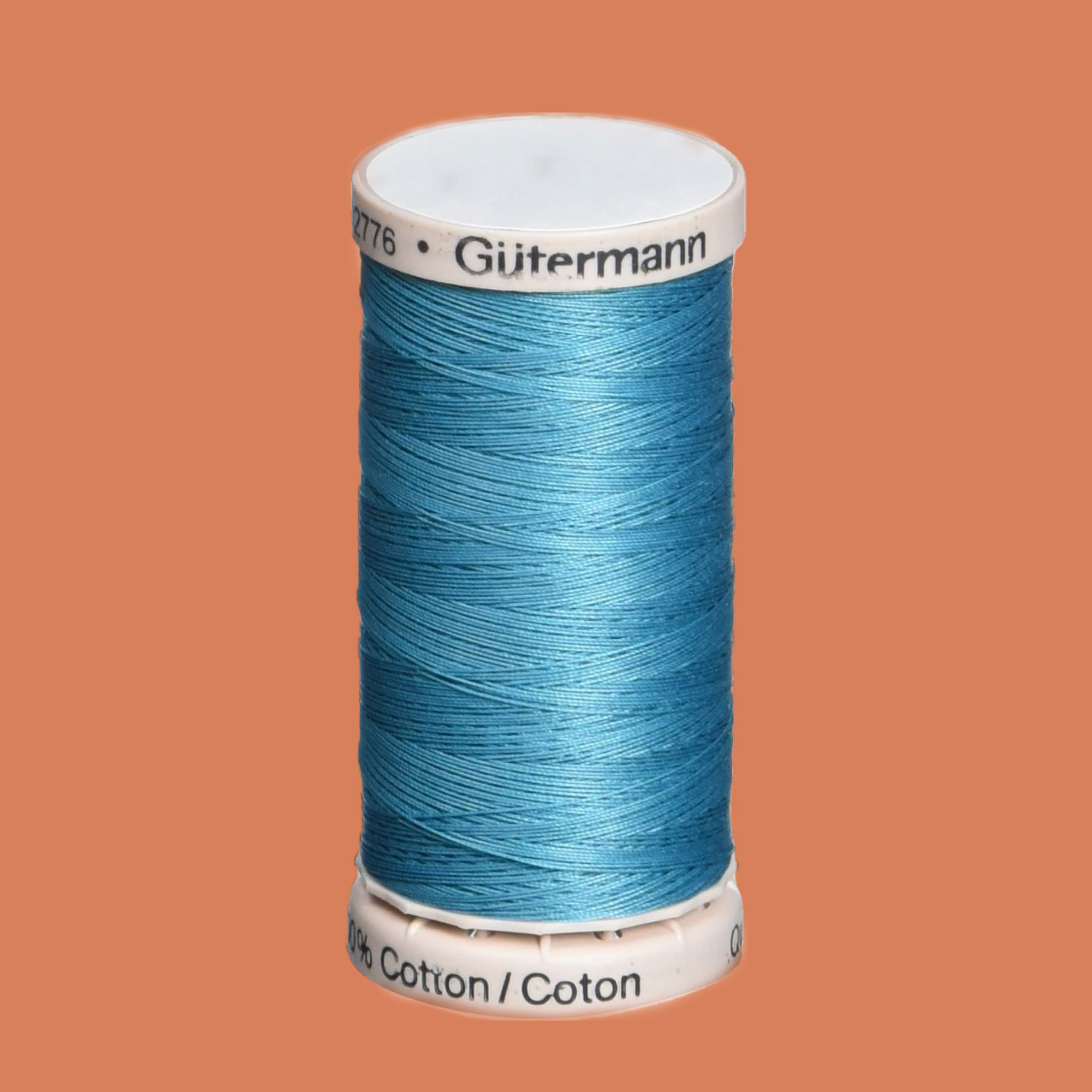 teal spool of quilting thread