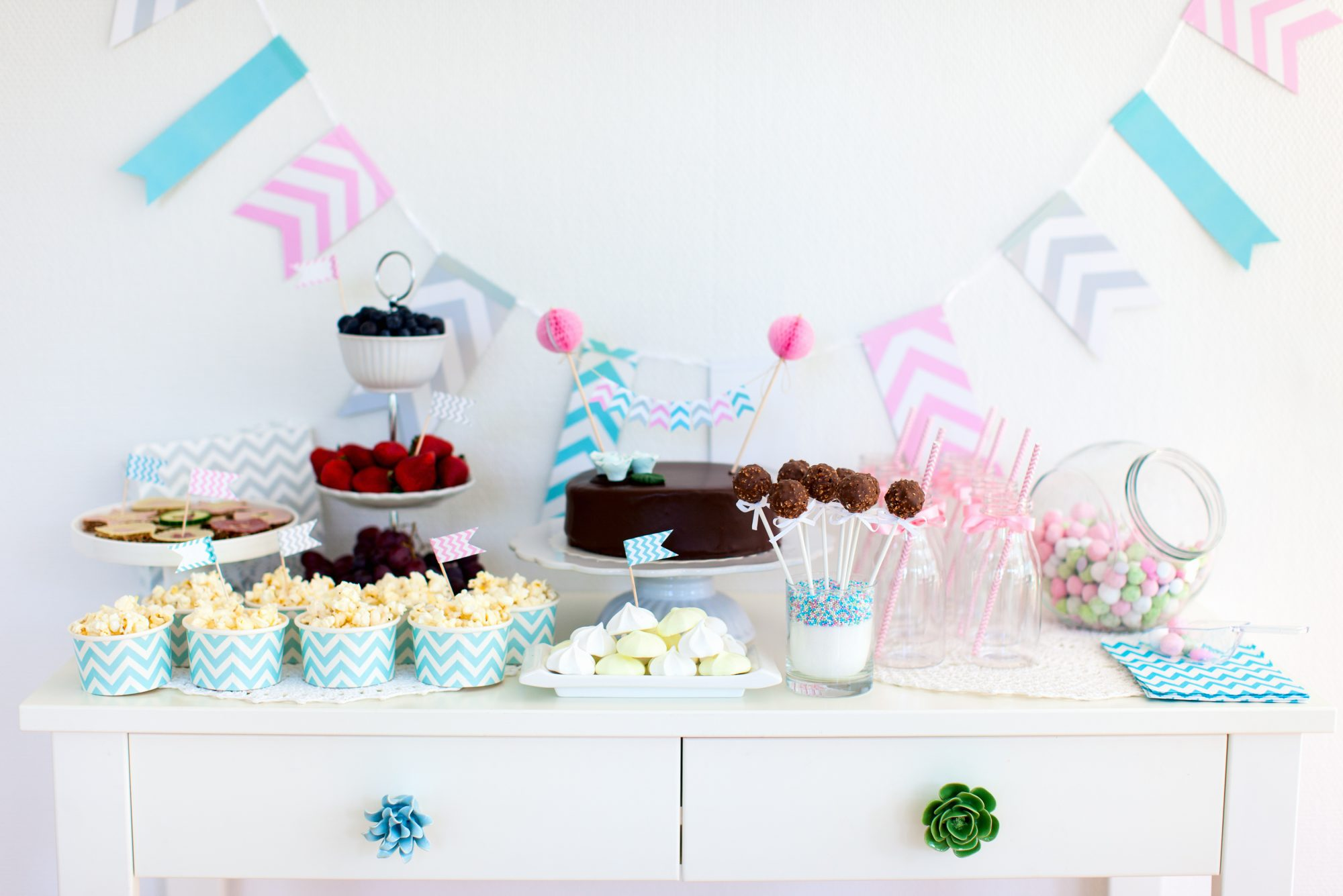 assortment of snacks on table for baby shower