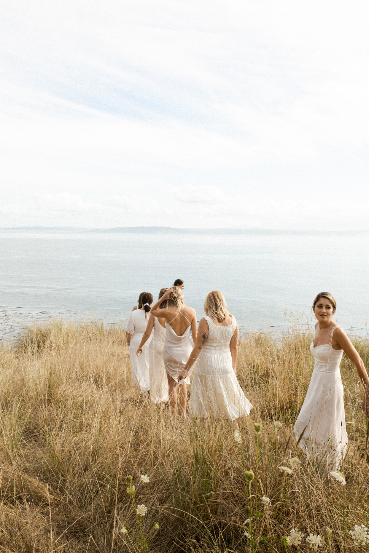 bridesmaids walking in grass