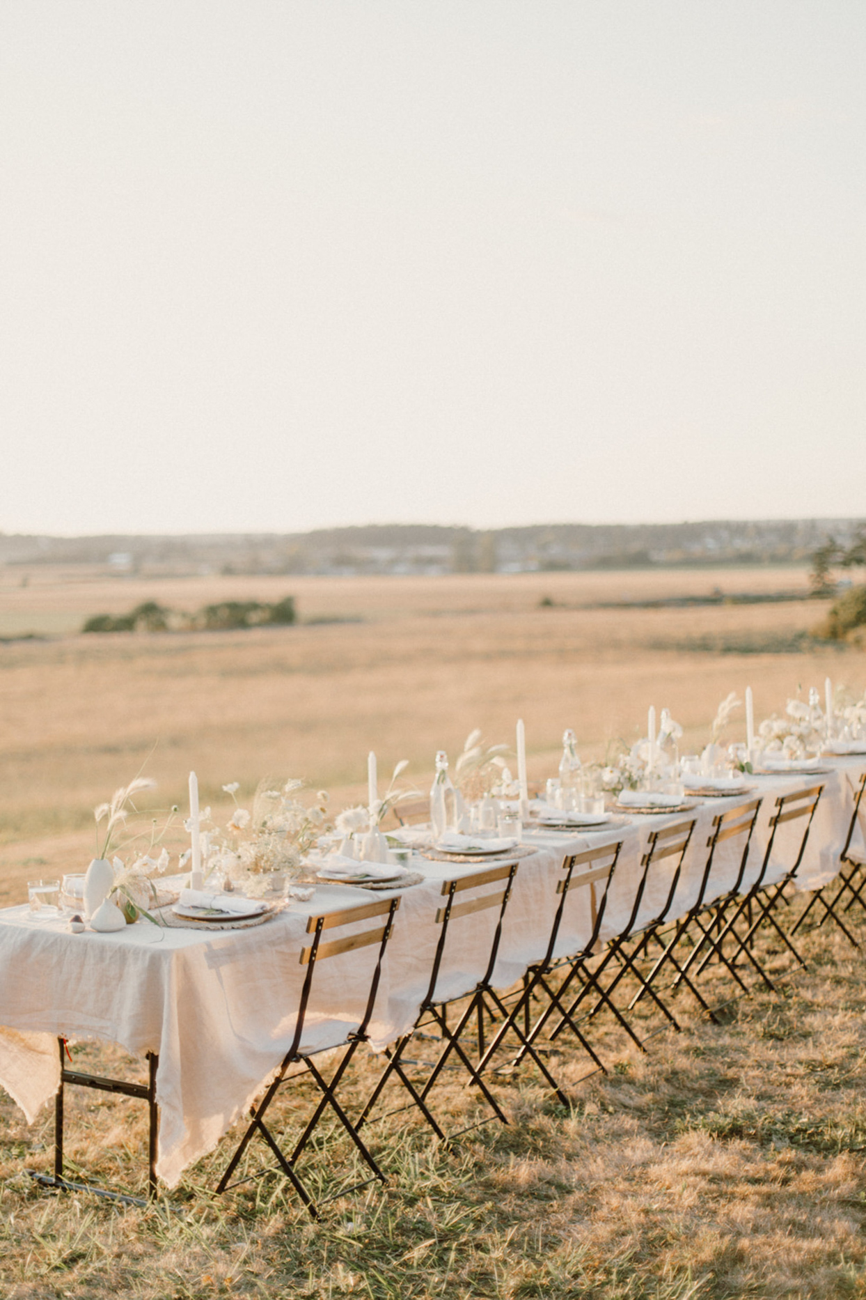 outdoor wedding dining space with long table